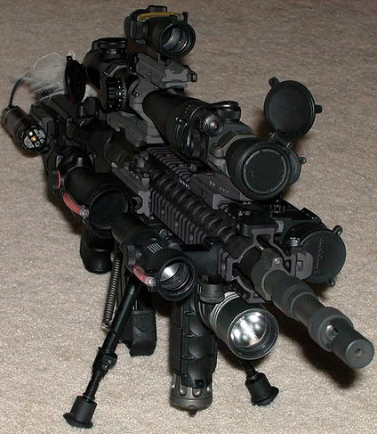 image of a gun with tons of scopes on top of it