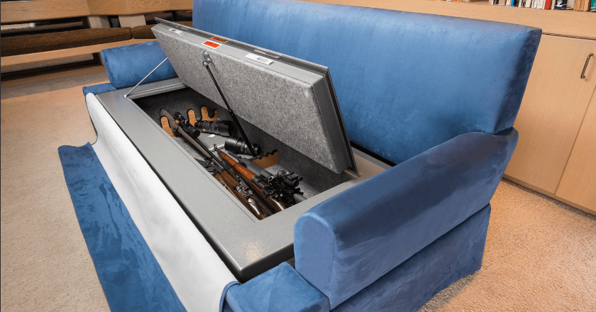 image of a blue couch with guns hidden inside