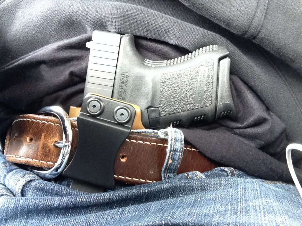 a picture of a glock tucked in an IWB holster