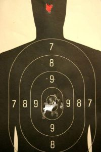 a picture of a target with hits in center mass