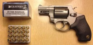 a picture of .32 H&R Magnum cartridges with a Taurus revolver