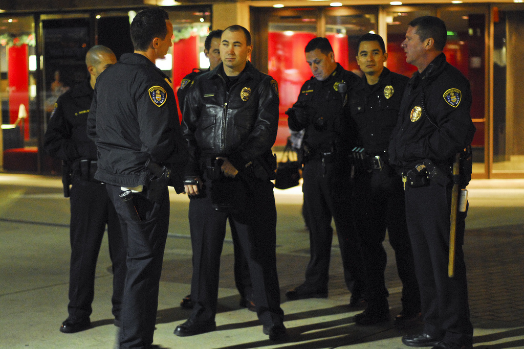 image of San Diego Policemen standing while waiting