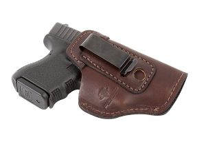 Pistol inside brown leather holster