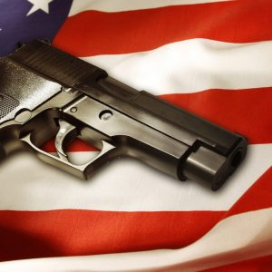image of a gun lying in american flag