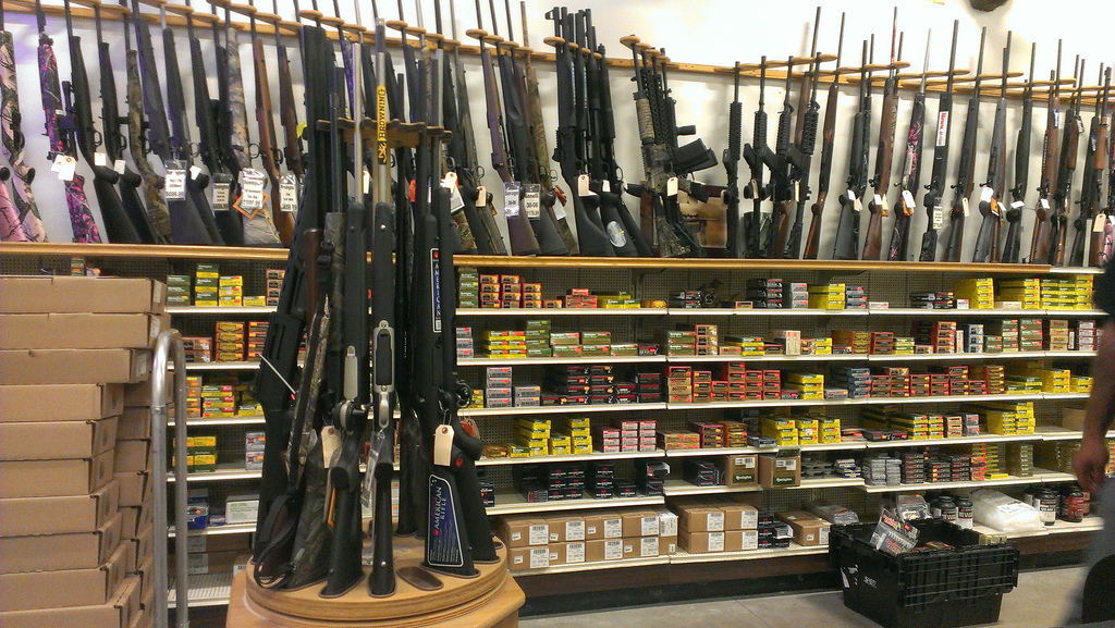 image of rifles and ammunition in a gun store