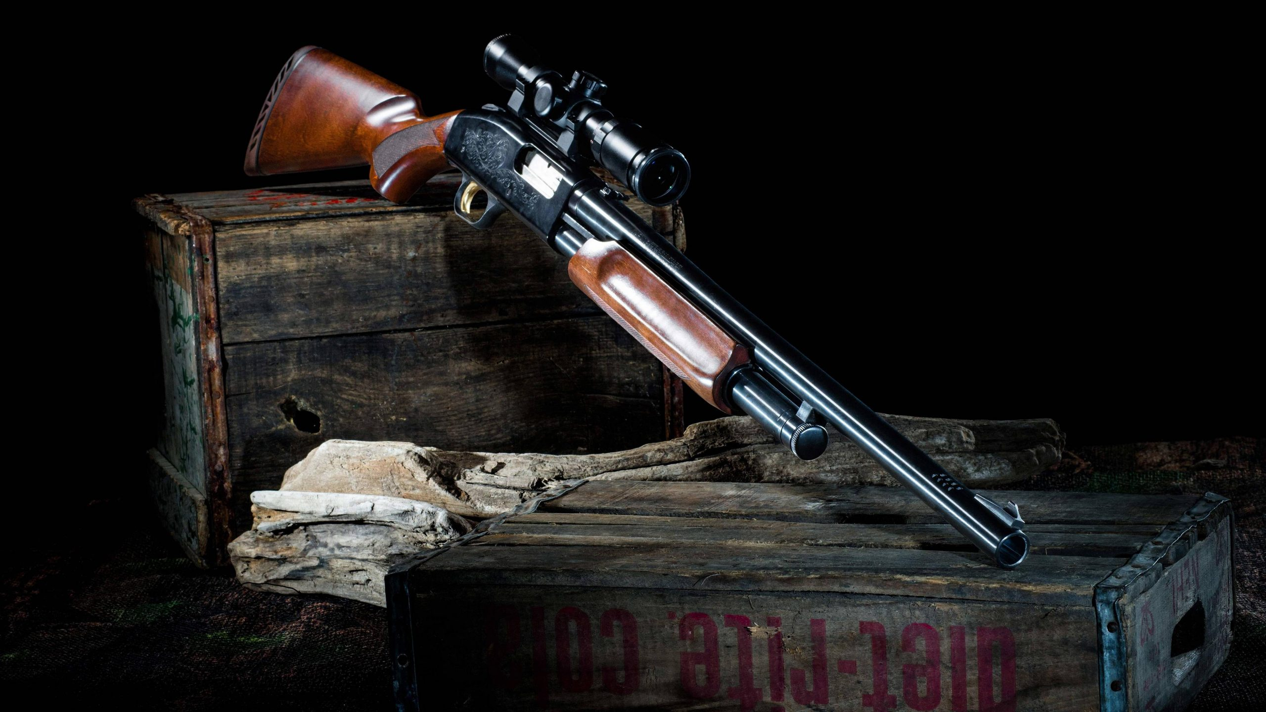 image of a shotgun placed on top of a wooden box