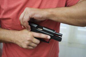 Man loads a gun pistol