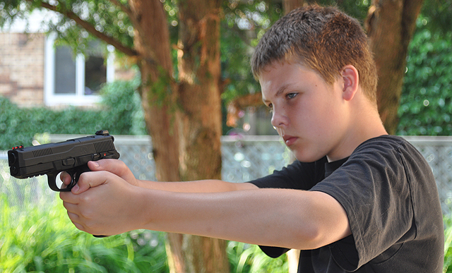 teenager with gun