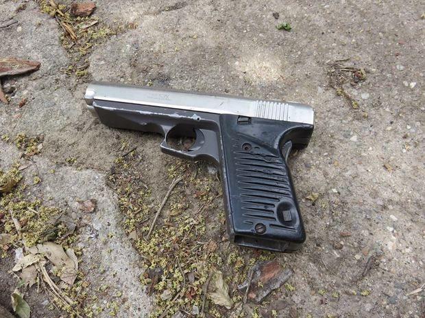 tossed gun