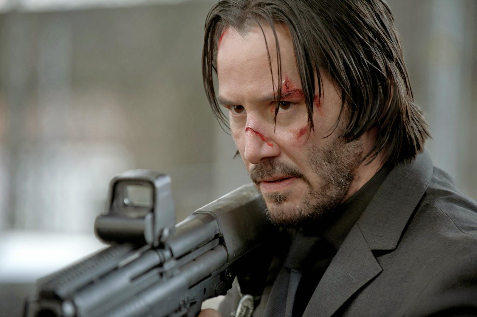 image of john wick holding a shotgun