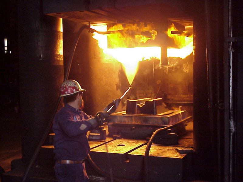 Image of a man forging alluminum