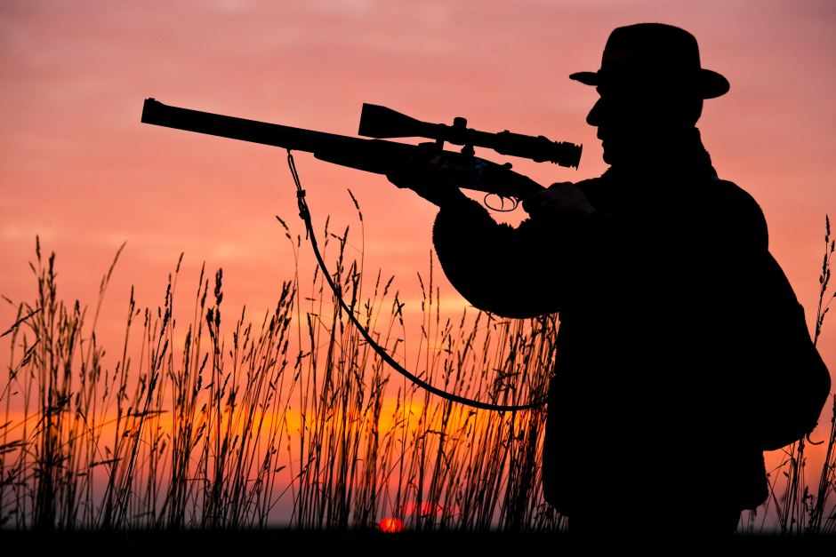Image of a man holding rifle silhouette