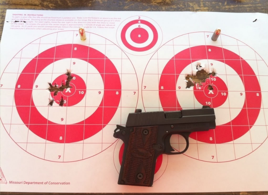 two range targets side by side after a day at the range with my sig p238 - 25 yards out