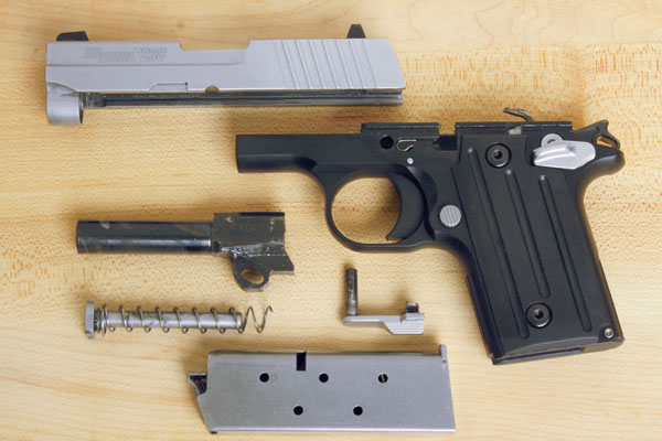 schematic of the sig sauer p238 disassembled on wood