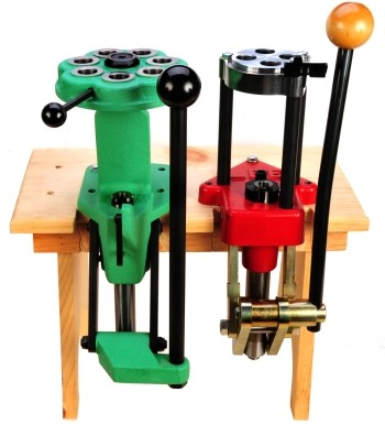 red and green turret reloading presses attached to wooden work bench in 2017