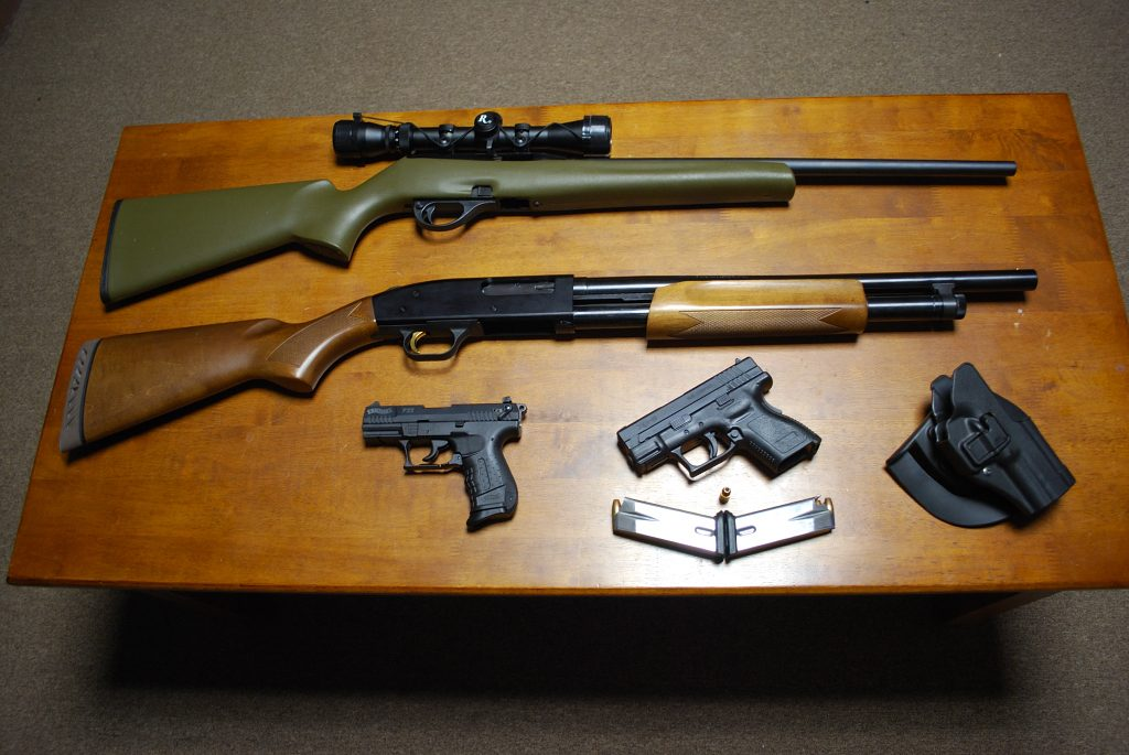 desk showing a bunch of great concealed guns