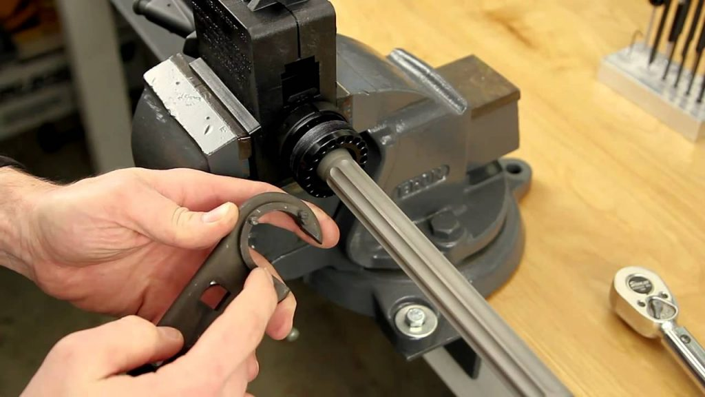 image of a man installing gas tubes on upper receiver
