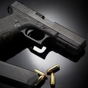 image of a handgun with bullets