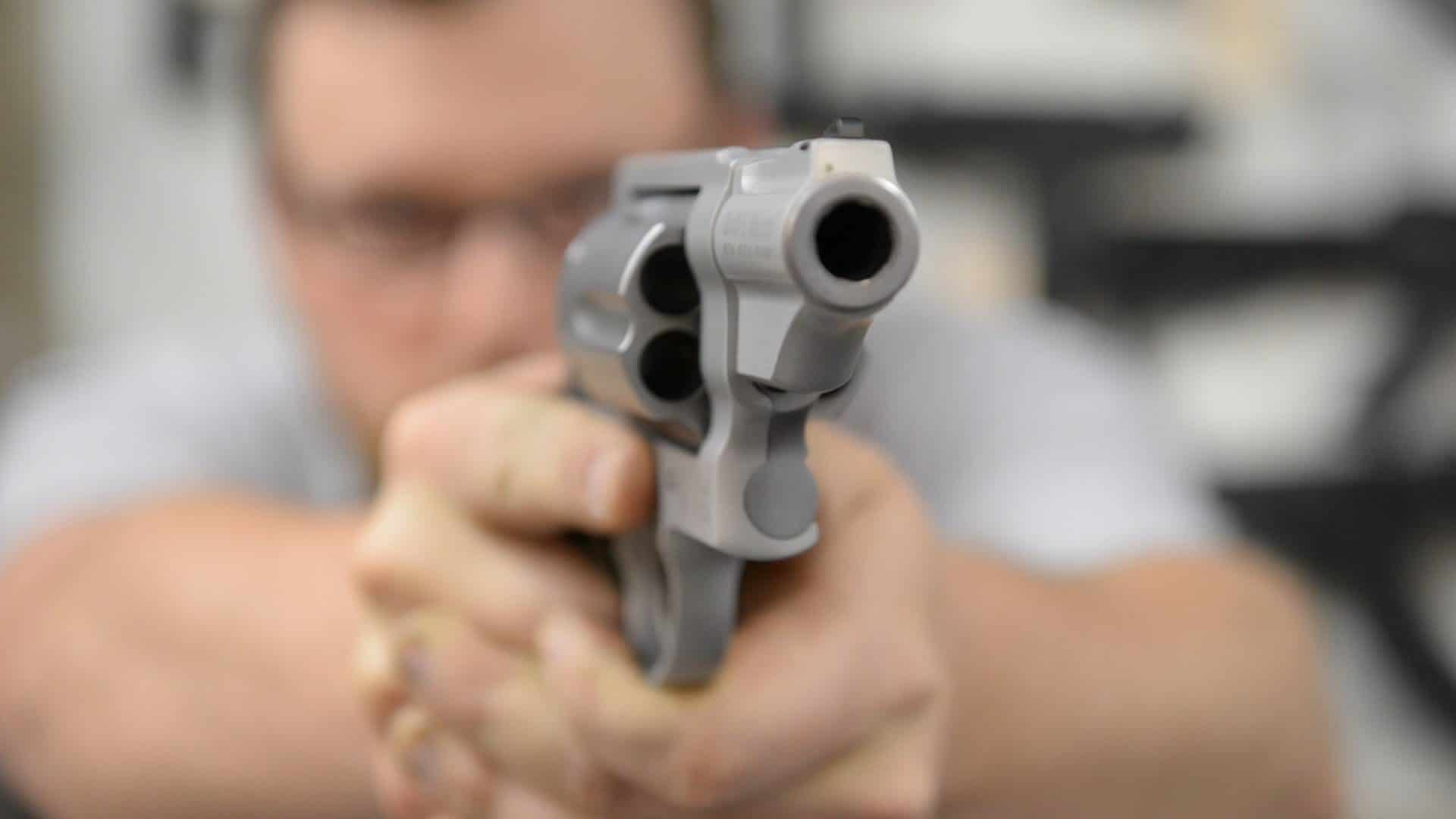 image of a man pointing a revolver