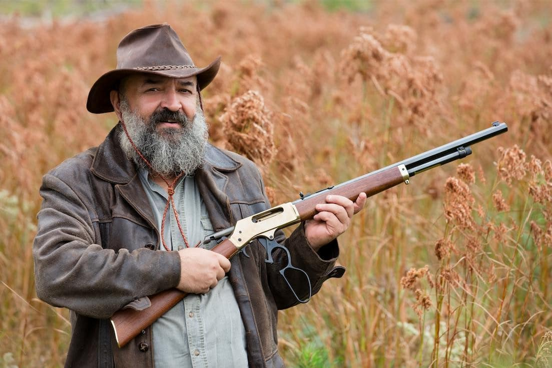 old man with beard holding the best lever action rifle in 2017