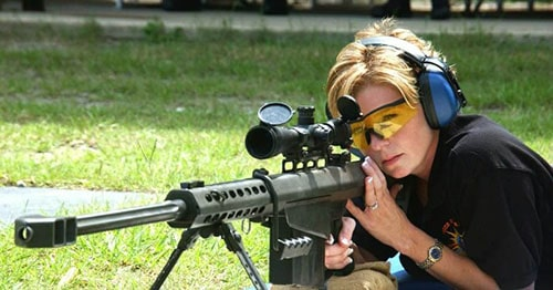 image of a woman wearing a shooting hearing protection