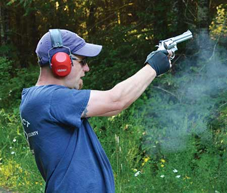 picture of a guy shooting a magnum revolver