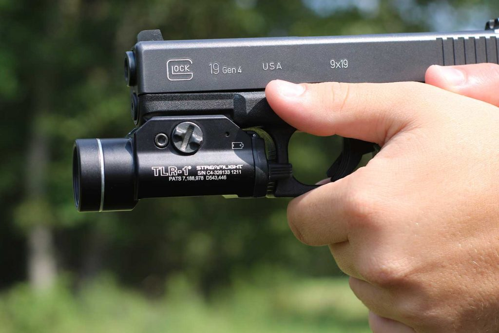 picture of a glock 19 with a flashlight attached