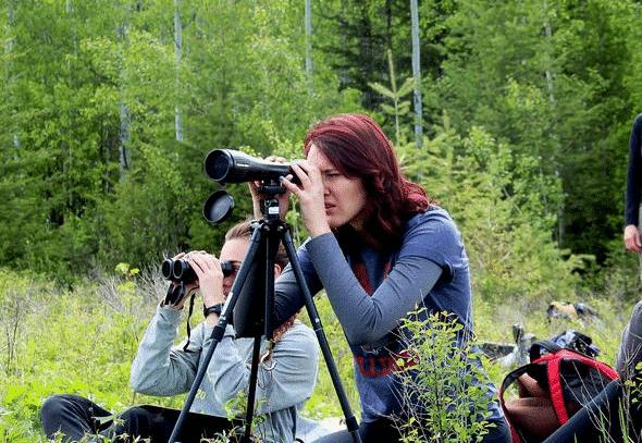 image of a woman sighting Nightforce spotting scope