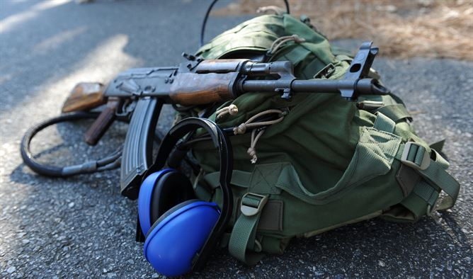 image of a range bag with a rifle and ear muff