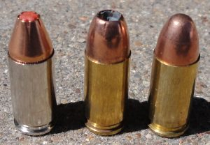 a picture of three 9mm cartridges with different bullet types