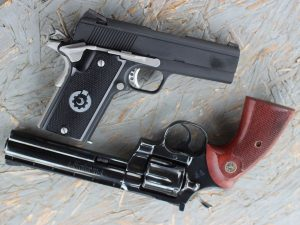a picture of a coonan and a colt python