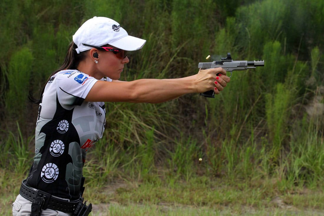 a picture of jessie duff shooting a race gun