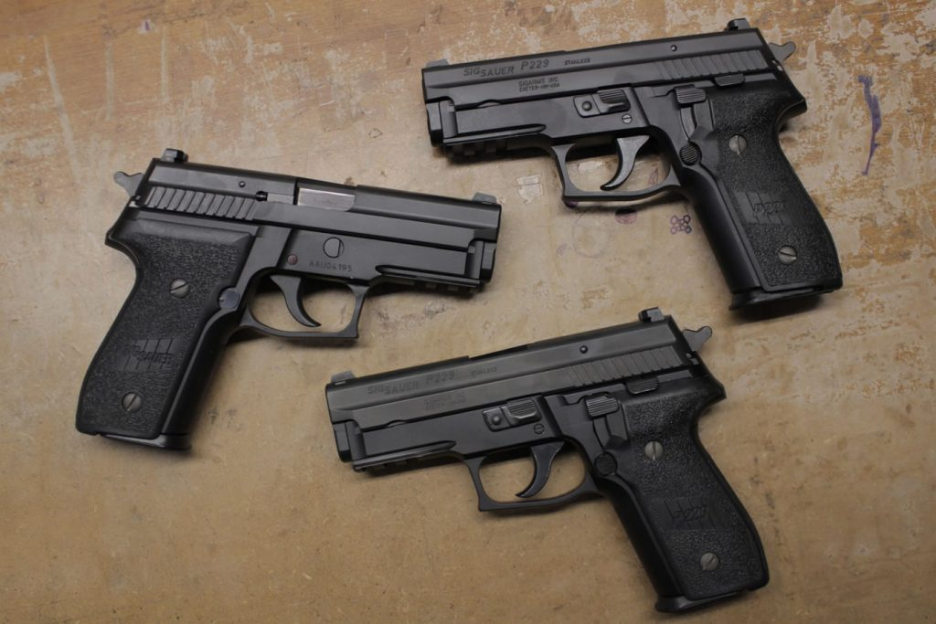 a picture of three sig p229s