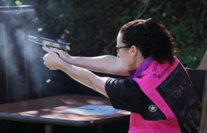 a picture of a woman shooting a 1911
