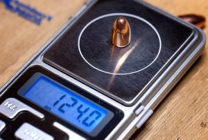 a picture of a bullet weighing scale