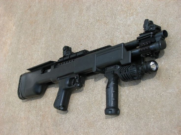 a picture of a mossberg 500 bullpup fully pimped out