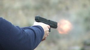 a picture of someone's arms shooting a glock 9mm
