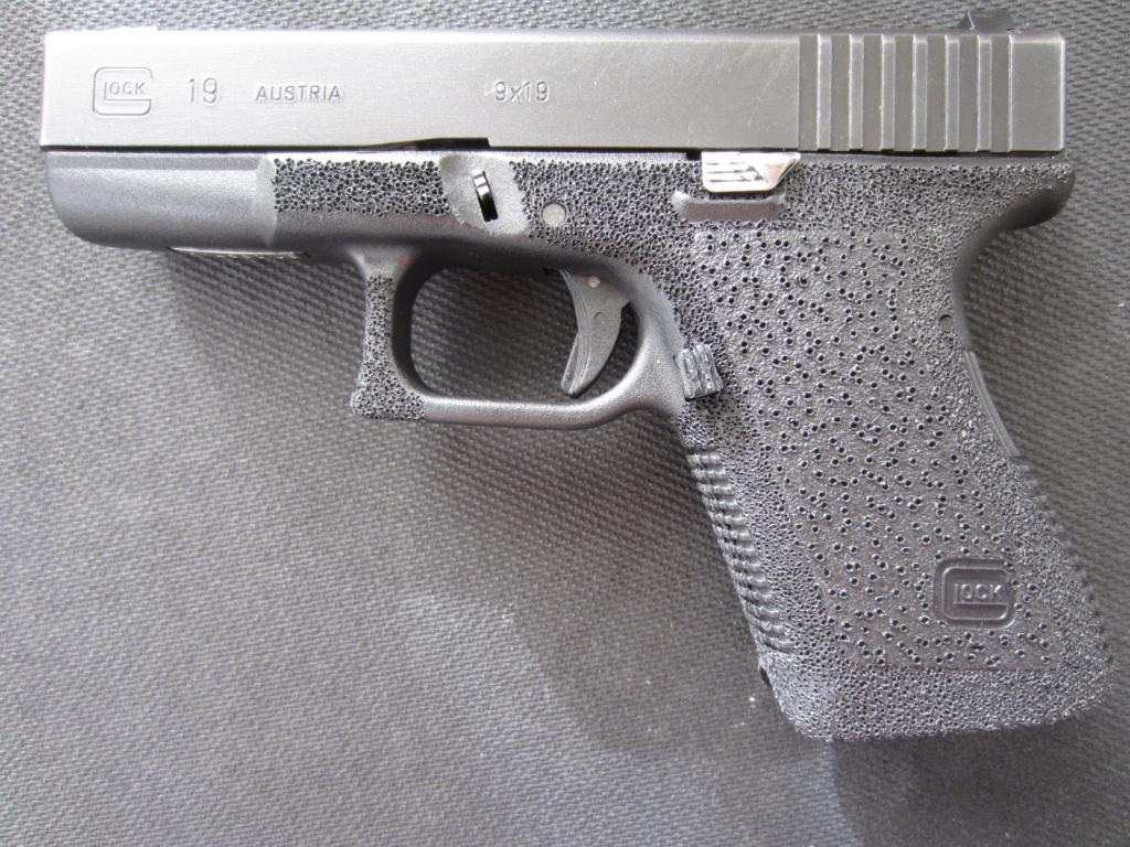 a picture of an ugly stippling job on a glock