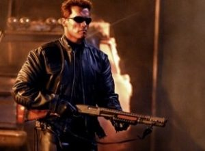 a picture of arnold schwarzenegger holding a remington 870