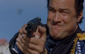 a picture of steven seagal holding a glock