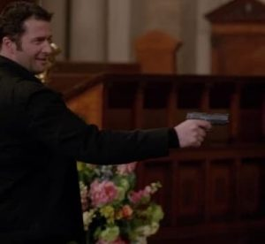 a picture of james purefoy holding a bersa bp9cc