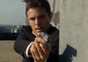 a picture of casey affleck holding a kahr mk9