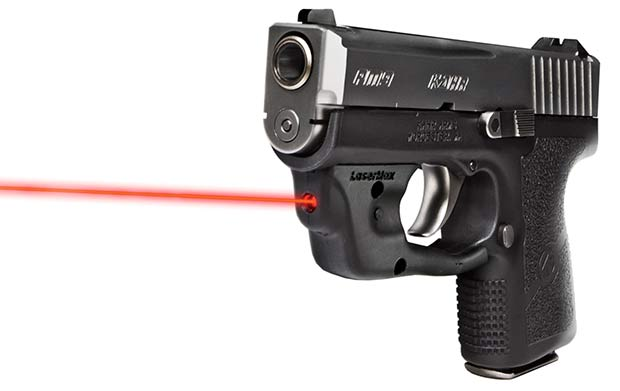 a picture of a kahr pm9 with a lasermax centerfire attached