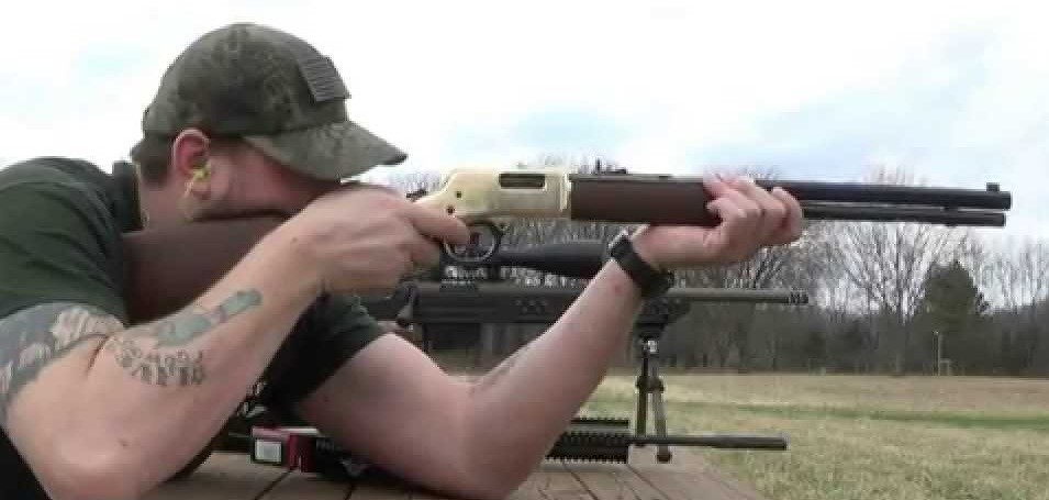 a picture of a Guy Shooting a .44 Magnum Carbine
