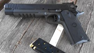 image of RIA 10mm on the table with handgun magazine