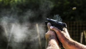 image of holding a gun aiming at something.