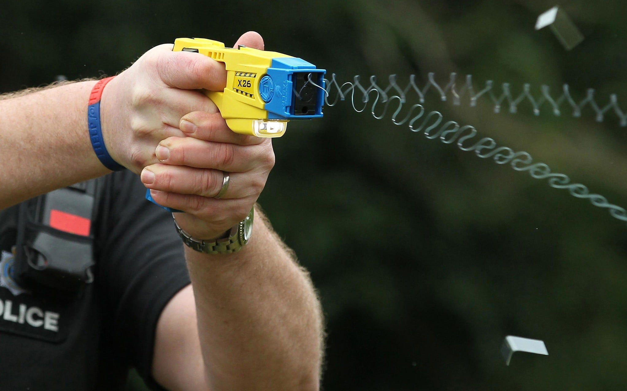 A picture of a Taser X2 being fired