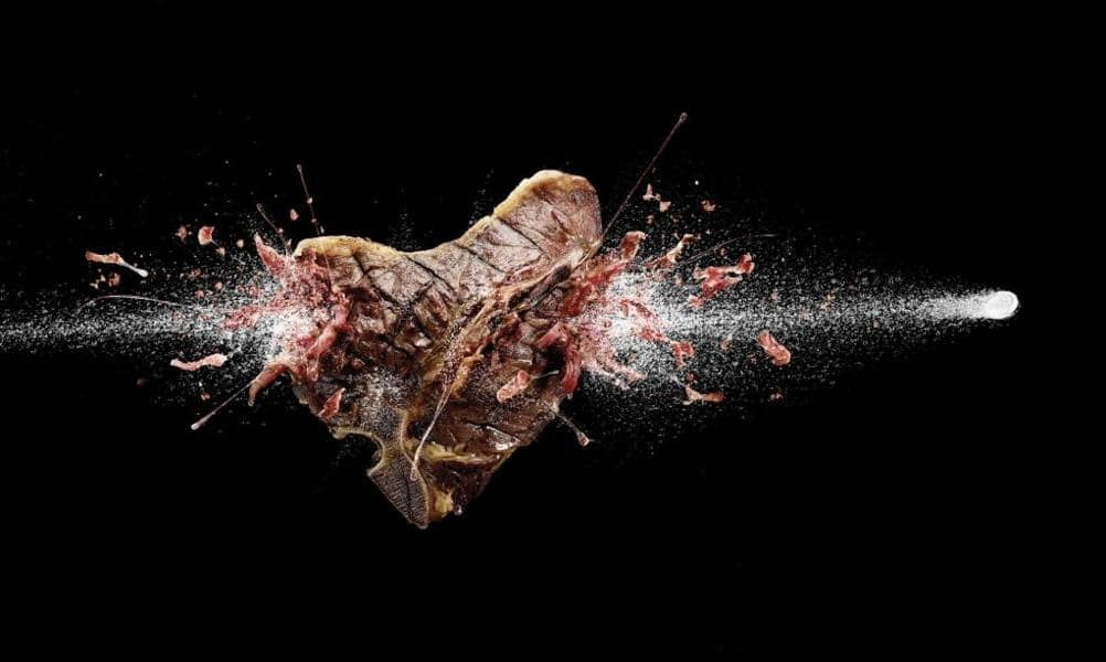 a picture of a bullet hitting a t-bone steak