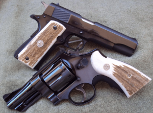 a picture of a 1911 and a S&W revolver