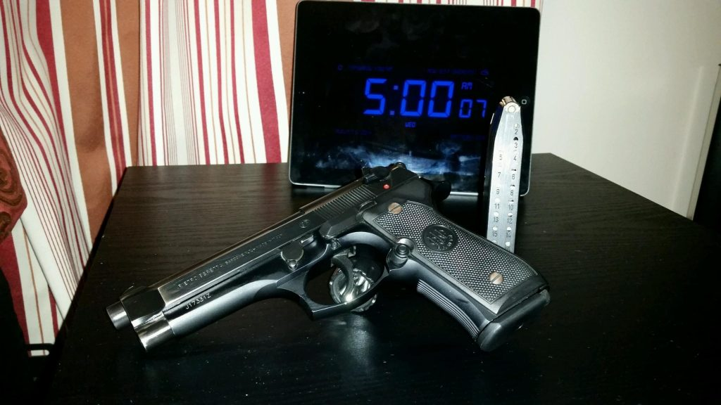a picture of a Beretta M92FS as a night stand gun